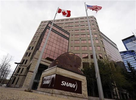 Flags fly over the Shaw Communications corporate headquarters in Calgary