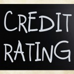"""""""Credit rating"""" handwritten with white chalk on a blackboard"""