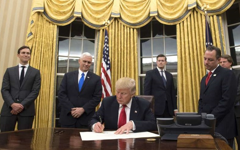 trump signing in oval office