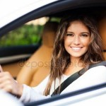 Auto insurance - woman in car - depositphotos