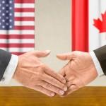 Representatives of the USA and Canada shake hands