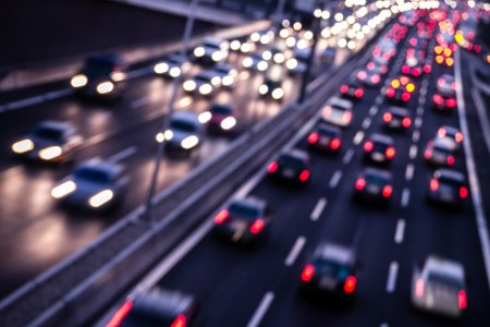 traffic on a highway at night - Depositphotos